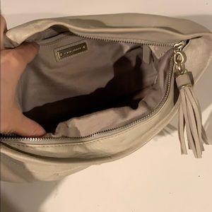 Banana Republic Bags - Bone leather slouchy clutch with tassel zipper